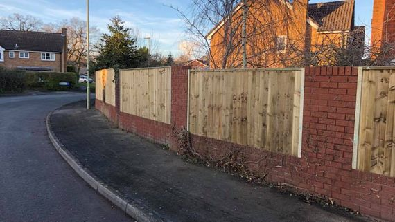 A customers fence we erected that has close boards and fixed between walls.